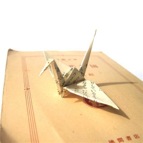 Folding 1000 Paper Cranes - unique origami cranes made from vintage japanese novel