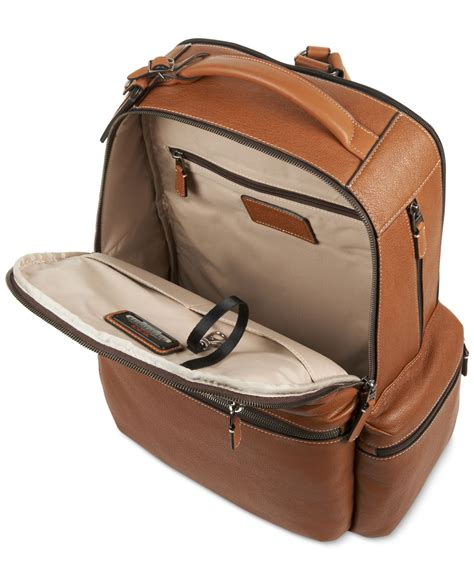 lyst tumi beacon hill rever brief pack in brown for