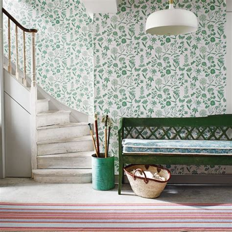 green wallpaper hallway hallway with green floral wallpaper and painted bench