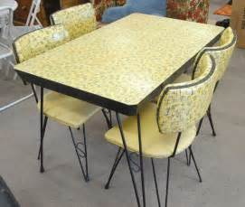 Vintage kitchen tables and fantastic chairs on grey carpet flooring