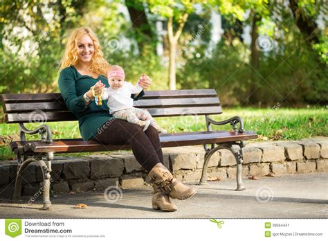 bench sitting mom with baby on a park bench stock photo image 39564441