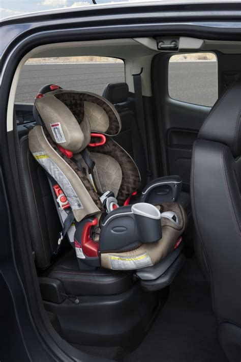 car seats for trucks 2015 gmc flips its headrest for car seat safety