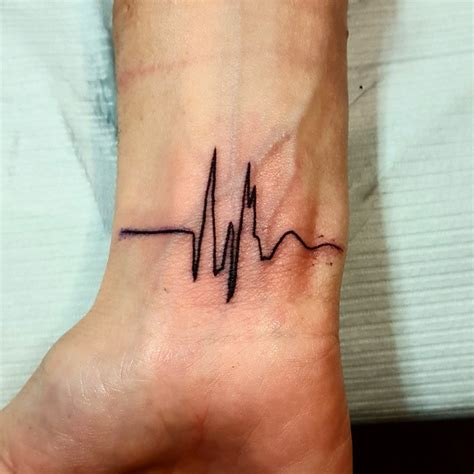 black ink tattoos for men 35 satisfying heartbeat designs ideas images