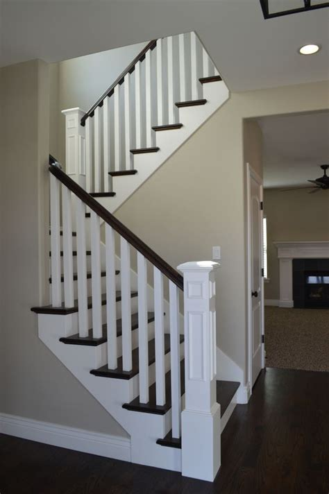 Hardwood Handrails For Stairs open railing with hardwood stairs we how the wood and white painted wood look