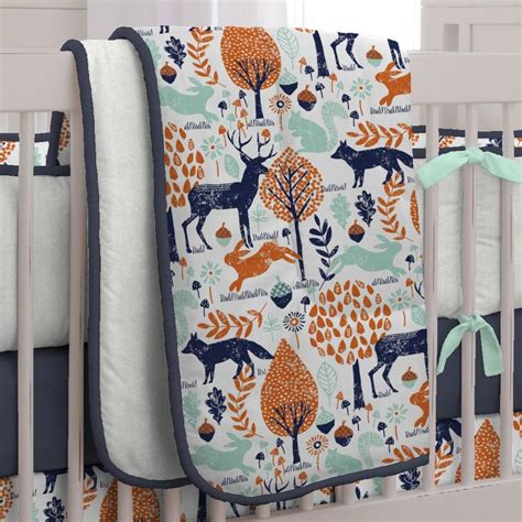 navy and orange woodland crib bedding carousel designs