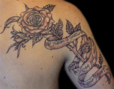 rose tattoo with scroll photos by aaron mclean