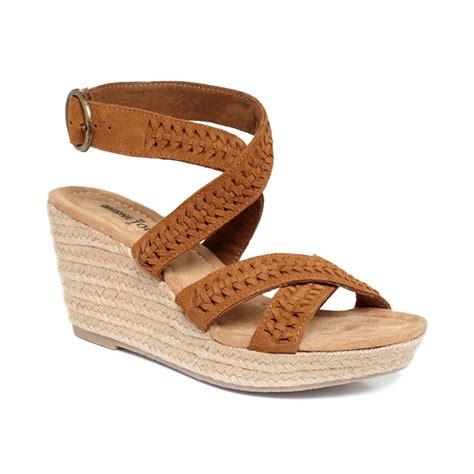 brown wedge sandals minnetonka platform wedge sandals in brown brown