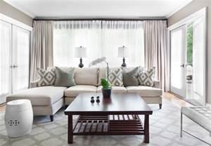 living room designs rectangular wooden table white curtains round ceramic seat white sofa glass