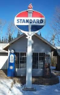 My shop office with a standard torch pole sign and wayne 60 gas pumps