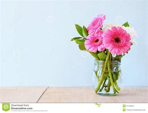 flower on table summer bouquet of flowers on the wooden table with mint background vintage filtered image stock