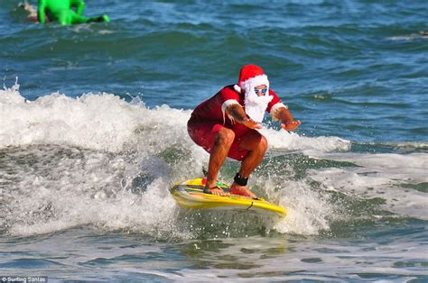 santa on surfboard ten thousand pack florida for surfin santa daily mail