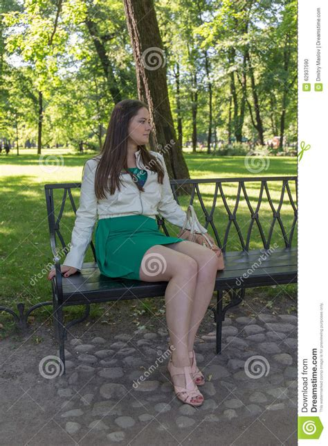 girl sitting on a bench girl sitting on a bench stock photo image 62937590