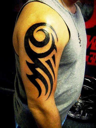 Bold Charming Tribal Tattoo On Biceps Tattooshunt Com Bold Tribal Forearm