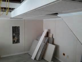 basement drop ceiling hides hvac system and gives the