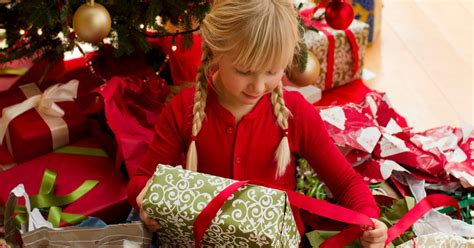 Christmas: Parents save up for the big day by cutting back ... Happy Kids Opening Christmas Presents