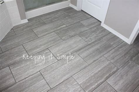 how to tile a floor how to tile a bathroom floor with 12x24 gray tiles hometalk
