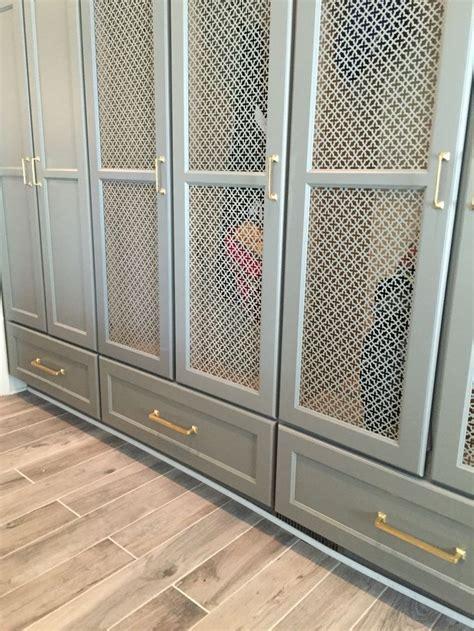 gray cabinets  metal mesh insert wardrobe doors