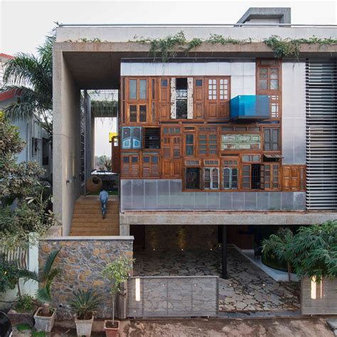 fashion design houses in mumbai reclaimed windows and doors form facades of collage house