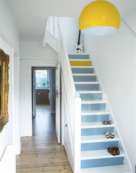 white hallway with painted stairs yellow l and one yellow step looks feel free to