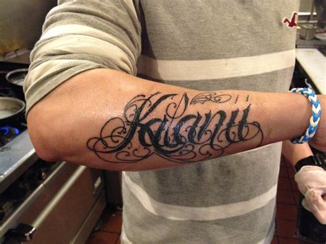 girls name forearm tattoo tattered artistry tattoos