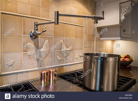 How To Install A Pot Filler Faucet by Wall Mounted Pasta Pot Filler Faucet With Running Water Usa Stock Photo Royalty Free Image