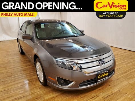 pre owned  ford fusion hybrid base fwd  sedan