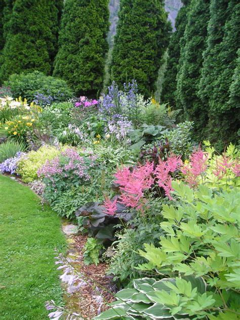 here is one of my flower beds with a list of some of the