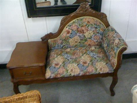 Antique and vintage victorian sofa with fabric cover wooden legs and flower pattern plus table