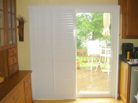 plantation shutters on a sliding glass door traditional
