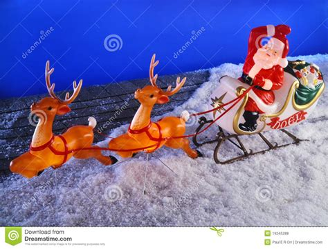 santa clause and reindeer on roof stock photo image