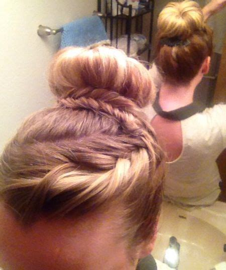 scalp braids in a high bun high sock bun with wrap around fishtail braid braid