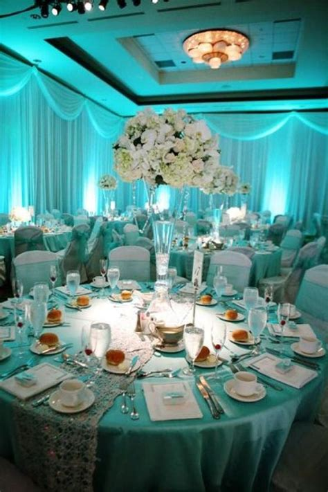 Aqua Blue And Silver Wedding Decorations by Soft Blue Lighting With White Blush And Green