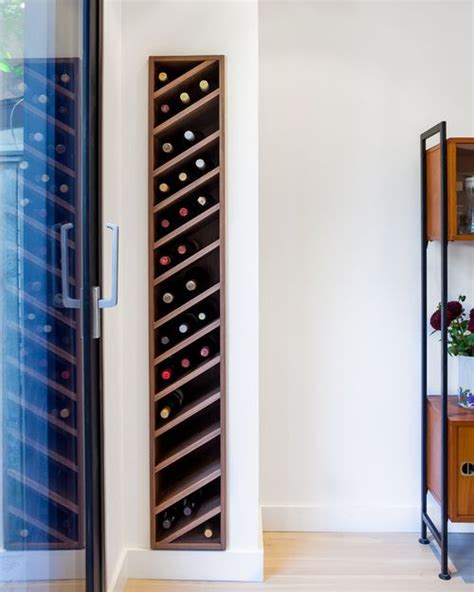 wine rack in living room carefully detailed custom walnut wine rack is slotted discretely into the living room wall