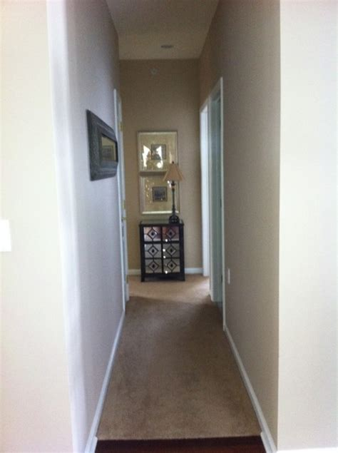 how to make narrow face look wider need help with this boring narrow hallway