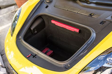 porsche trunk in first drive porsche 718 cayman racing yellow in south