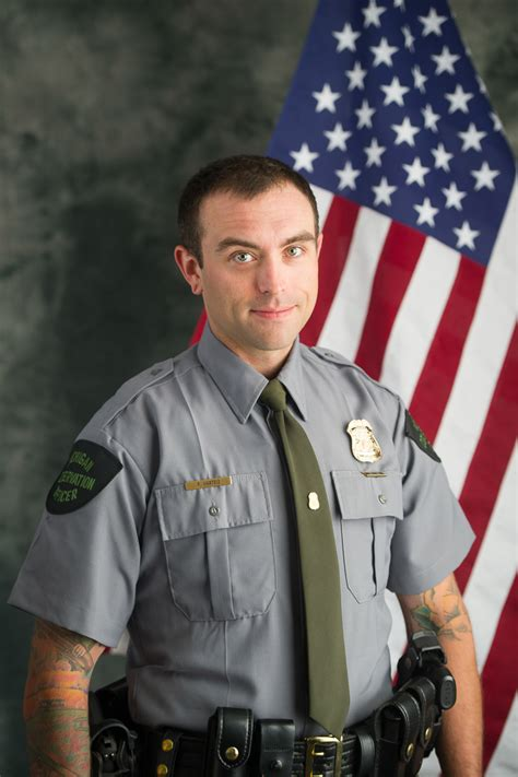 Officer In Michigan by Som Dnr Conservation Officer Rescues Runaway Boy From