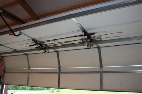 Rods Overhead Door This Fishing Rod Rack Securely Fastens To Garage Doors And Holds Up To Six Rods No Tools