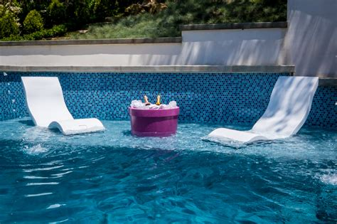 in pool lounge chairs ledge lounger the ultimate in water pool furniture luxury pools