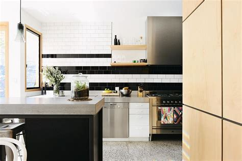 black and white backsplash trend 20 ways to add stripes to your kitchen