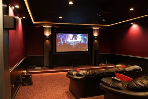 home theater with molding and indirect lighting