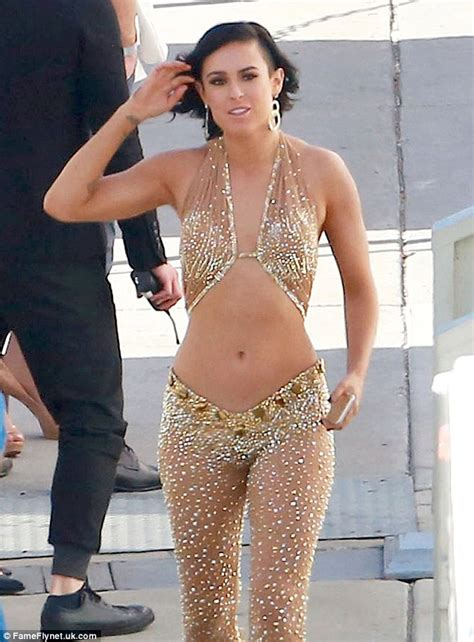 Rumer Willis Likes Putting Condoms In by Rumer Willis Showcases Flat Stomach In Shimmering Cut