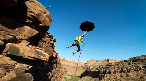 rock swings daredevil rock climbers create a giant rope swing over the