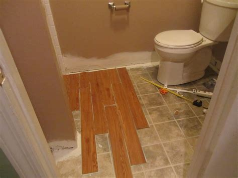 wood flooring in the bathroom vinyl wood bathroom and took me an hour to do this whole