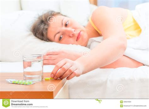 sick in bed images sick woman in bed stock photo image 56631904