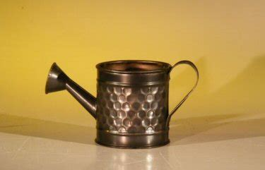 mini decorative watering can