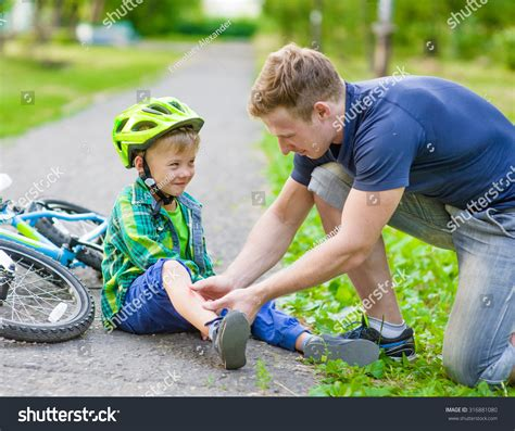 Baby Fell The by Putting Bandaid On Boys Stock Photo 316881080