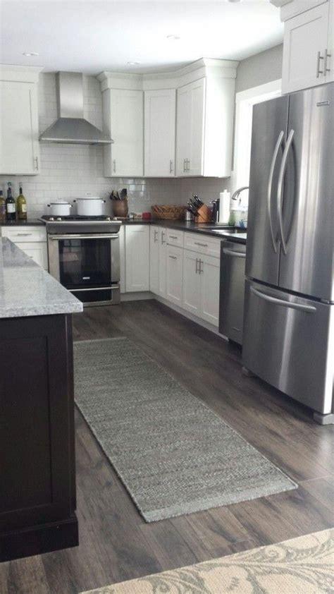 kitchen laminate flooring 25 best ideas about kitchen laminate flooring on laminate floor tiles laminate