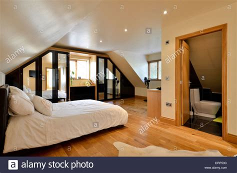 ensuite bedroom designs modern master bedroom with ensuite bathroom stock photo