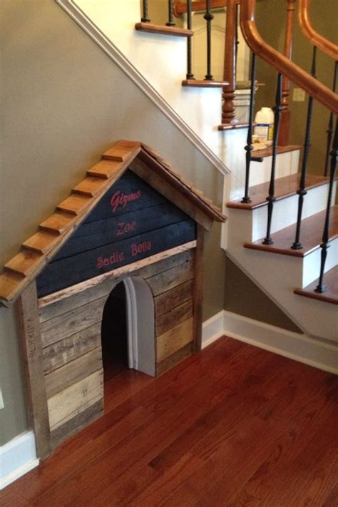 staircase dog house diy dog house built under the stairs bob vila s picks pets pinte