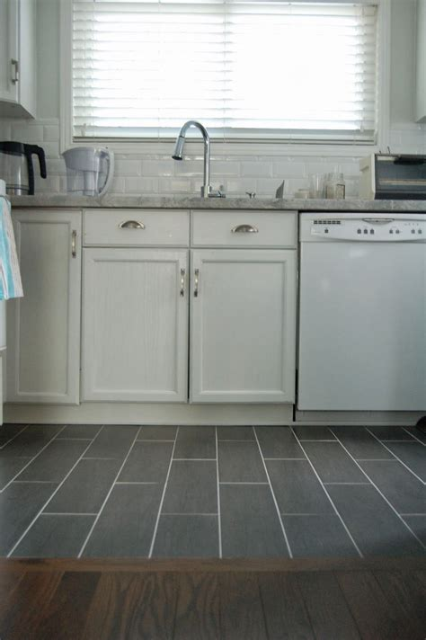 how to tile kitchen floor wood floor to tile transition kitchen remodel woods kitchens and kitchen floors